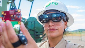 A BPX technician reads sensor information on her smart glasses out in the field that is relayed to an expert in the control center (Photo Source: BP)