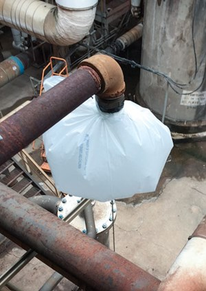 FIG. 5. Trash bag test on the after-condenser vent to measure the total non-condensable load from the surface condenser and inter-after condenser units.