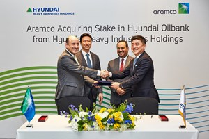 Saudi Aramco and Hyundai Heavy Industries Holdings (HHIH) formalize the agreement for the Hyundai Oilbank share purchase in Seoul, South Korea. Saudi Aramco is represented by Ziad Murshed, Vice President of International Operations (left) while HHIH by Jong-chul Kim, Senior Vice President and Head of Corporate Management Office (right). The signing ceremony were witnessed by Saudi Aramco Senior Vice President of Downstream, Abdulaziz Al Judaimi (right, standing) and HHIH's Ki-sun Chung, Senior Executive Vice President and Head of Group Corporate Planning (left, standing)