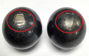 FIG. 2. Damaged balls with discoloration and flat spots 180° apart.